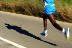 African Runner legs. On the road with panning blur Royalty Free Stock Image