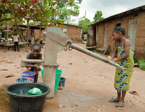 African rural girl child fetching water Stock Images