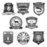 African safari animal hunting club badge set. African safari animal hunting club and outdoor adventure badge set. African elephant, lion, rhino, antelope stock illustration