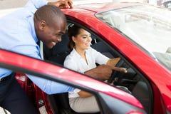 African salesman new car Stock Photo