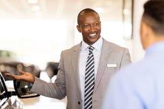 African salesman presenting car Stock Photography