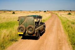 African Savannah. Jeep on safari in African savannah, Kenya Royalty Free Stock Photography
