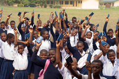African School Children. Free distribution of copies of the New Testament Bible in an African school royalty free stock photos