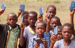African School Children. Free distribution of copies of the New Testament Bible in an African school royalty free stock images