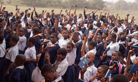 African School Children. Free distribution of copies of the New Testament Bible in an African school stock image