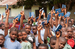 African School Children. Free distribution of copies of the New Testament Bible in an African school royalty free stock photography