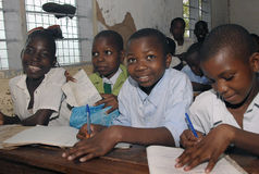 African school children. Four African school children sitting at their desks in class royalty free stock photos