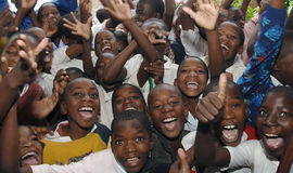 African school children. Many African school children looking and smiling at the camera stock photo