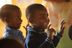 African School children singing. Mozambique refugee school children in south africa stock photography