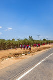 African School children walking on a road. African School children on their way to school royalty free stock photo