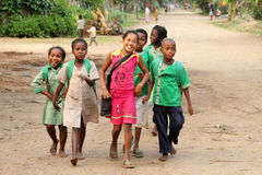 African schoolchildren. Group of children on their way to school, rural road near Mananara, Madagascar Royalty Free Stock Photos