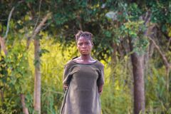 African schoolgirl in green school uniform against a forest background royalty free stock images