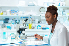 African scientist, medical worker, tech or graduate student. Works in modern biological laboratory Stock Photo
