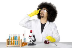 African scientist thinking an idea on studio. Image of African male scientist thinking an idea while doing chemical research, isolated on white background Stock Photography