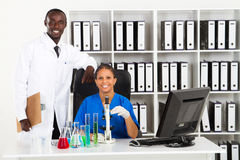 African scientists. Two happy african scientists posing together in medical laboratory stock photography