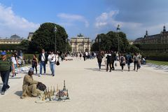 African selling souvenirs in Paris, France Royalty Free Stock Images