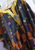 African Shirt. Colorfully woven African top shirt on hanger Royalty Free Stock Images