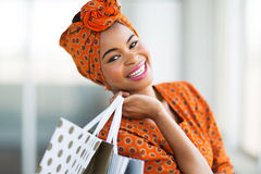 African shopper mall. Happy attractive african shopper in shopping mall stock photography
