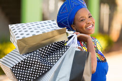 African shopper mall. Happy african shopper carrying shopping bags in mall Royalty Free Stock Photo