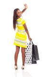 African shopper waving Stock Images