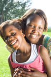 African sisters. Happy african sisters posing together stock image