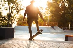 African skateboarder skating on a concrete skateboarding ramp Royalty Free Stock Images