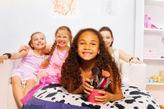 African small girl and her friends laying on bed Royalty Free Stock Image
