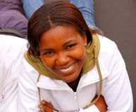 African smile. Outdoor head portrait of a beautiful African black woman with happy smiling facial expression showing her healthy white teeth stock photo