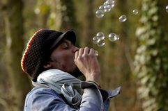 african and soap bubbles Royalty Free Stock Images