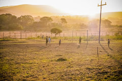 African soccer. A group of young Southafricans happily playing football Royalty Free Stock Image