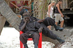 African soldiers resting on the beach Stock Photo