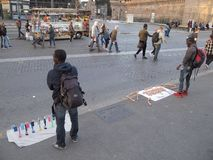 African Souvenirs sellers in historic center of Rome. Color sellers try to seller their wares to tourist passing royalty free stock images