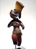 African statue. An african statue made of clay decorated with black geometric forms painted on top Stock Images