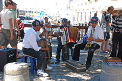 African street musicians on the Waterfront in Capetown, South Af. CAPE TOWN, SOUTH AFRICA - DECEMBER 30, 2007: African street musicians on the Victoria and Stock Photo