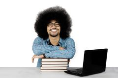 African student with books on studio Stock Images