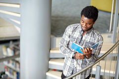 African student boy or man reading book at library Royalty Free Stock Photography