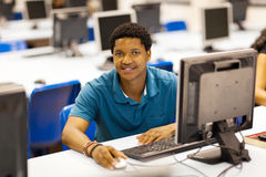 African student computer room. Male african college student in computer room Stock Images
