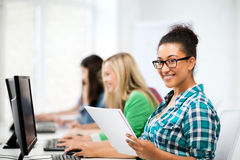 African student with computer studying at school Royalty Free Stock Image
