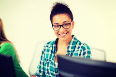 African student with computer studying at school. Education, technology and internet - african student with computer studying at school Royalty Free Stock Photos