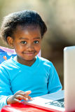 African student doing homework. Portrait of African student navigating on laptop Royalty Free Stock Image