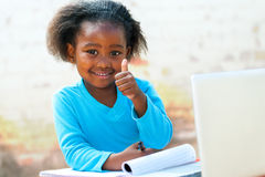 African student doing thumbs up. Stock Photos