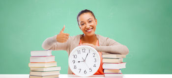 African student girl with books and clock Royalty Free Stock Photography