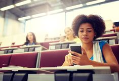 African student girl with smartphone at lecture royalty free stock photos