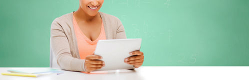 African student girl with tablet pc at school Royalty Free Stock Image
