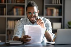 Free African Student Guy Do Tests Prepares For Entrance Exams Royalty Free Stock Image - 187753386