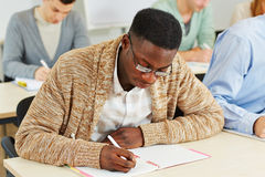 African student in university class. African student learning in a university class stock photo