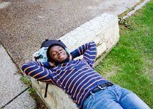 African student resting on bench Royalty Free Stock Photography
