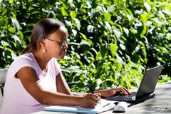 African student studying. Happy young african student studying outdoors Stock Images