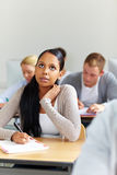 African student in university class. Female african student learning in university class stock photos
