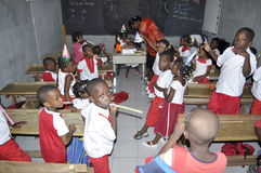AFRICAN STUDENTS IN CLASS. Single image of children breast garden in the class with their teacher to acquire knowledge and skills Stock Photography